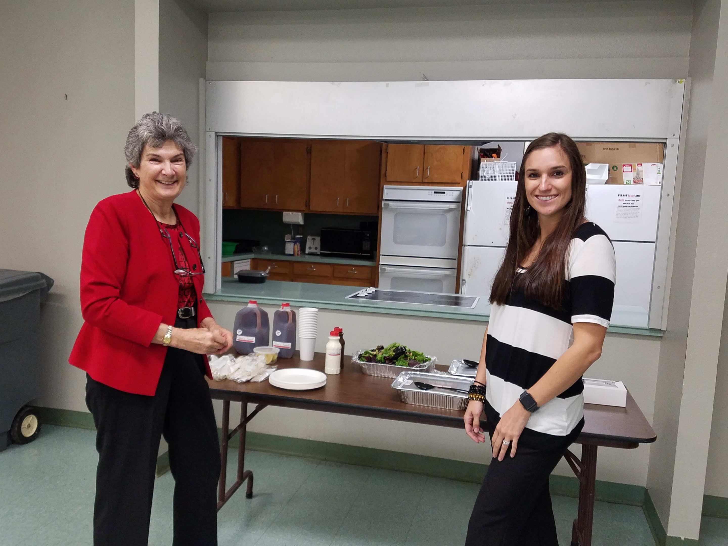 Commissioner Cook stands before a meal prepared by Wilco's Agrilife Family and Community Health Program Agent Chelsea Stevens.