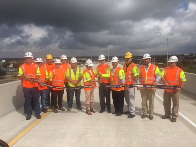 Commissioner Cook cuts the ribbon with Terry McCoy, Texas Department of Transportation Austin District engineer. Also participating were Round Rock Mayor Craig Morgan and others involved with the project.