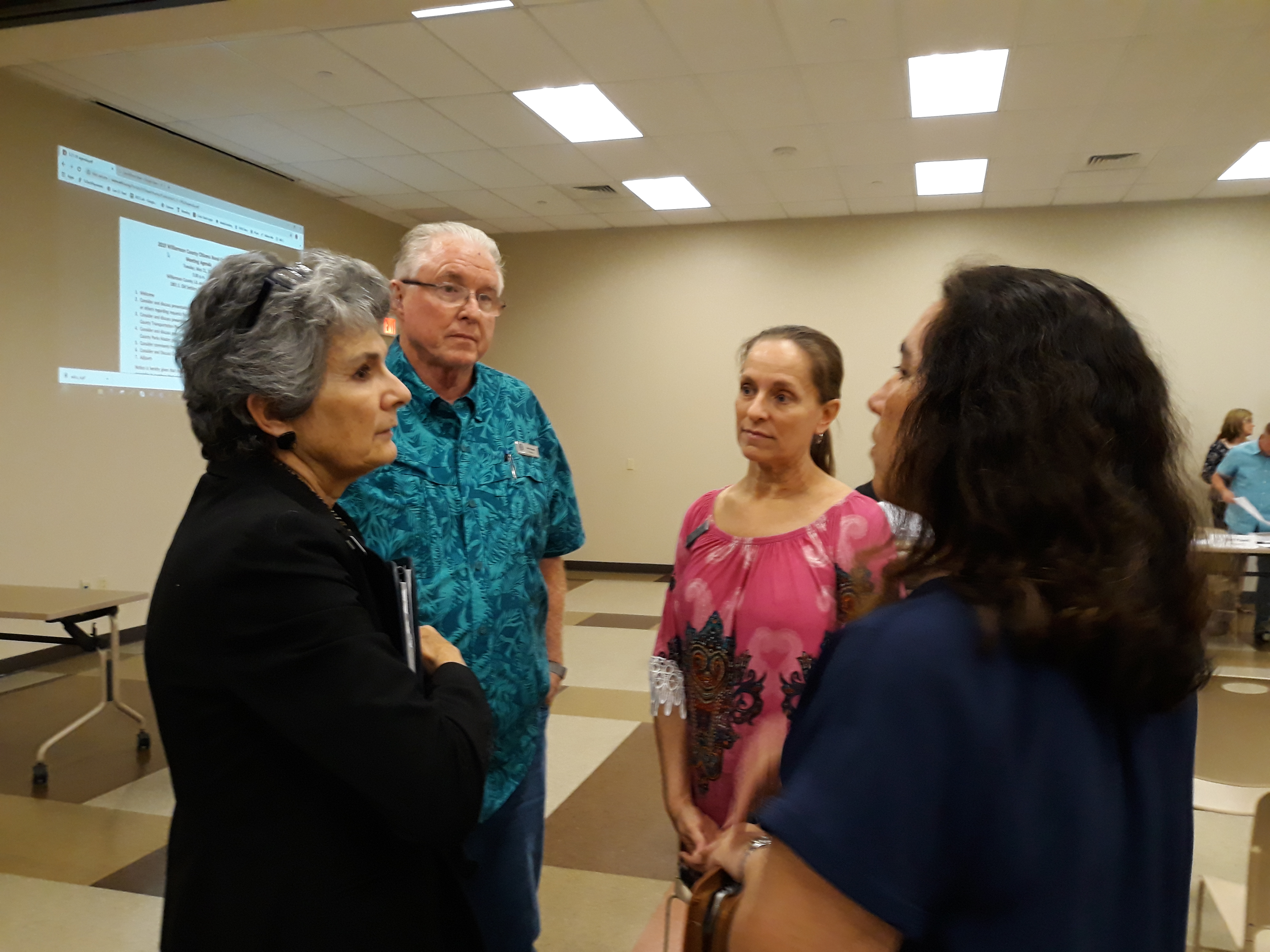 Commissioner Cook listens to project needs from members of the Upper Brushy Creek Water Control and Improvement District before the meeting.(rt) Alysha Girard, General Manger; (center) Kathy Cook, Director; and Mike Freeman, President .