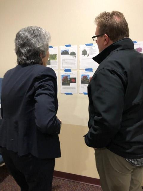 Commissioner Cook answers questions about landscape planning for Neenah Ave. to Davis Spring resident Mike Harkrider.
