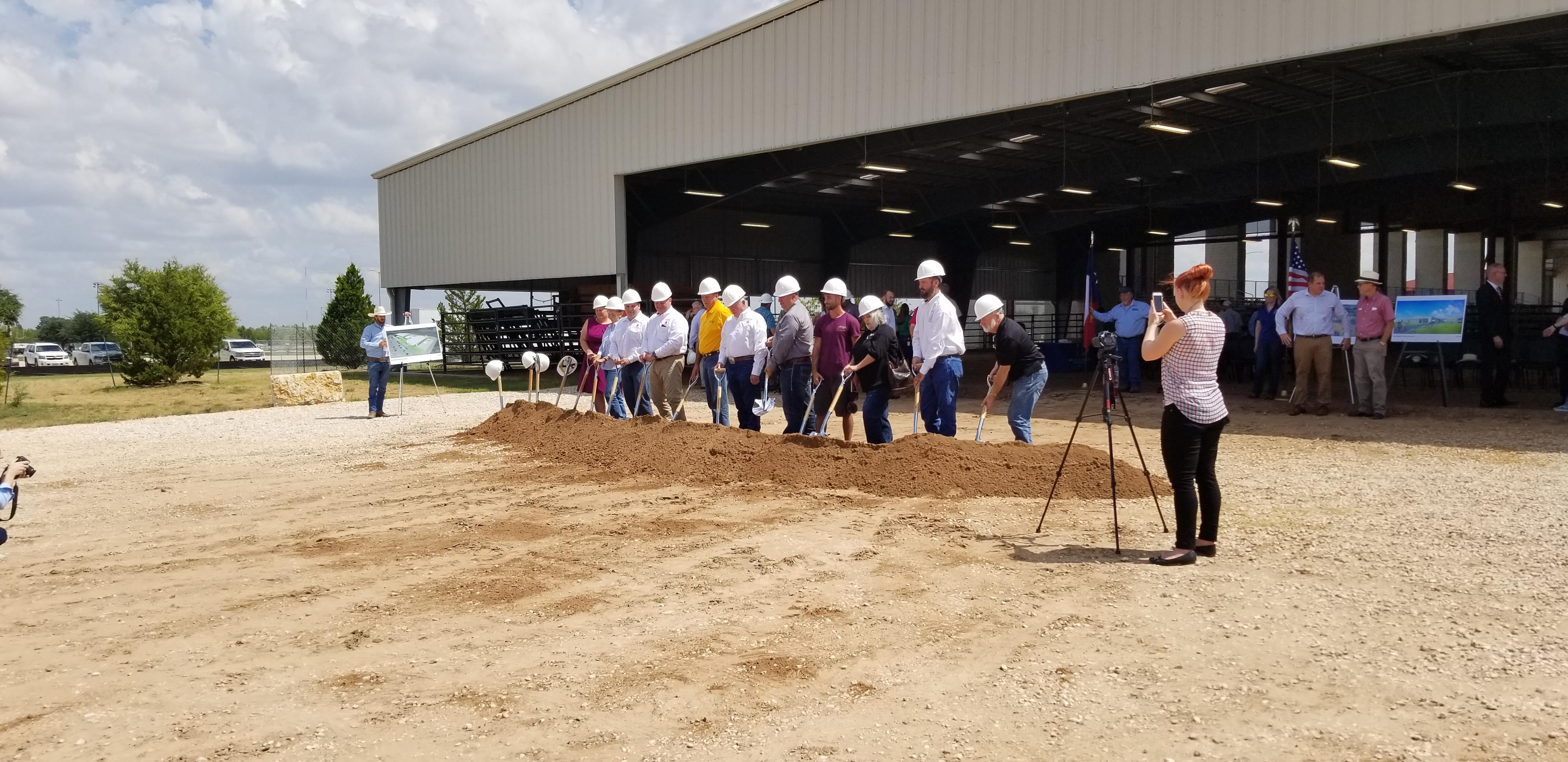 Commissioner Cook joins several officials including Pct. 4 Commissioner Russ Boles who all donned hard hats and are holding shovels ready for the signal to break ground.