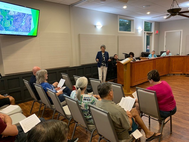 Commissioner Cook speaks to Fern Bluff residents at their MUD Board meeting.