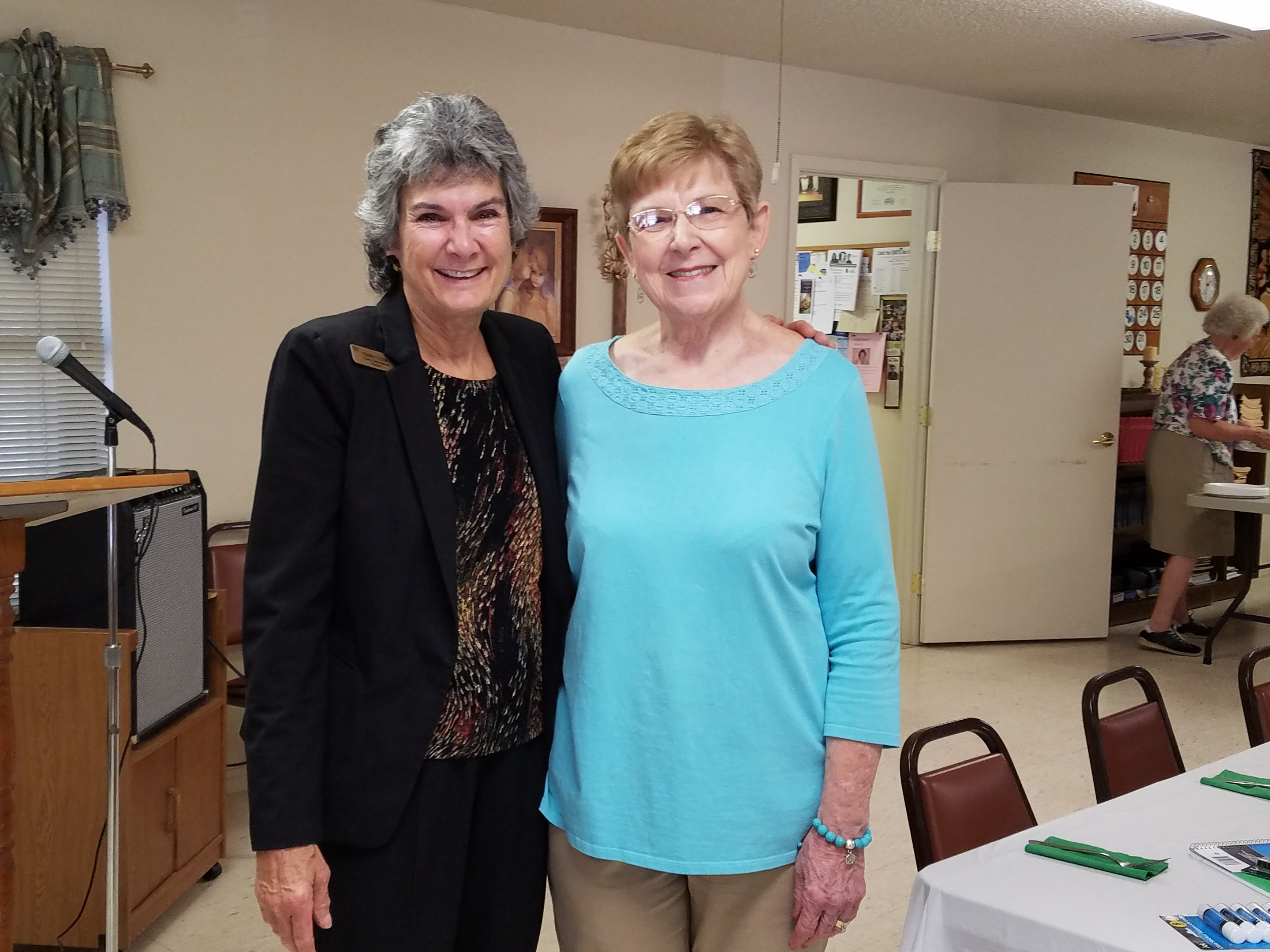 Commissioner Cook and Susan Komandasky, Coordinator of the August luncheon.