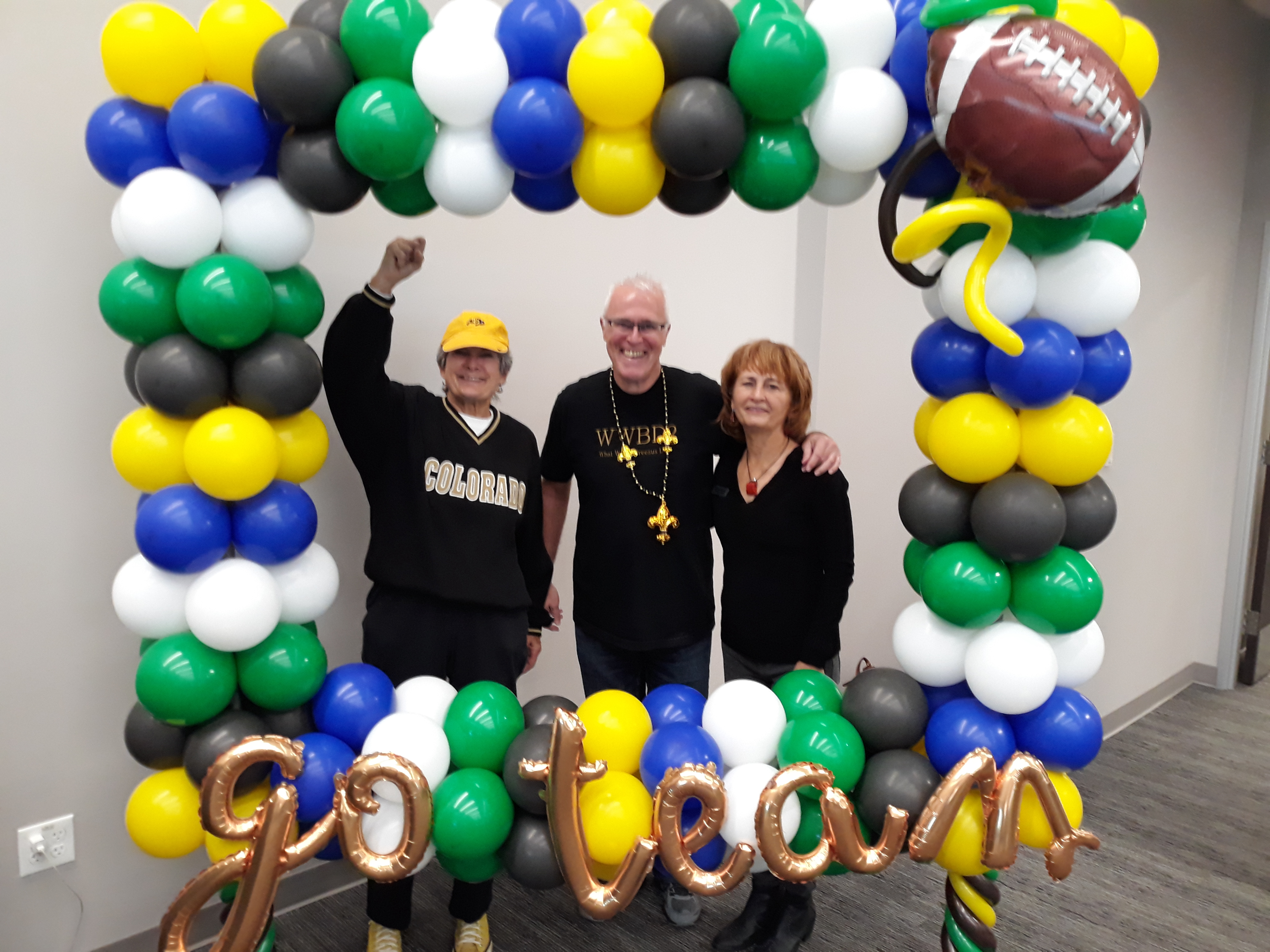 Commissioner Cook wore her University of Colorado sweatshirt and appears to be rooting for her team at the photo booth with her staff Garry Brown and Doris Sanchez.