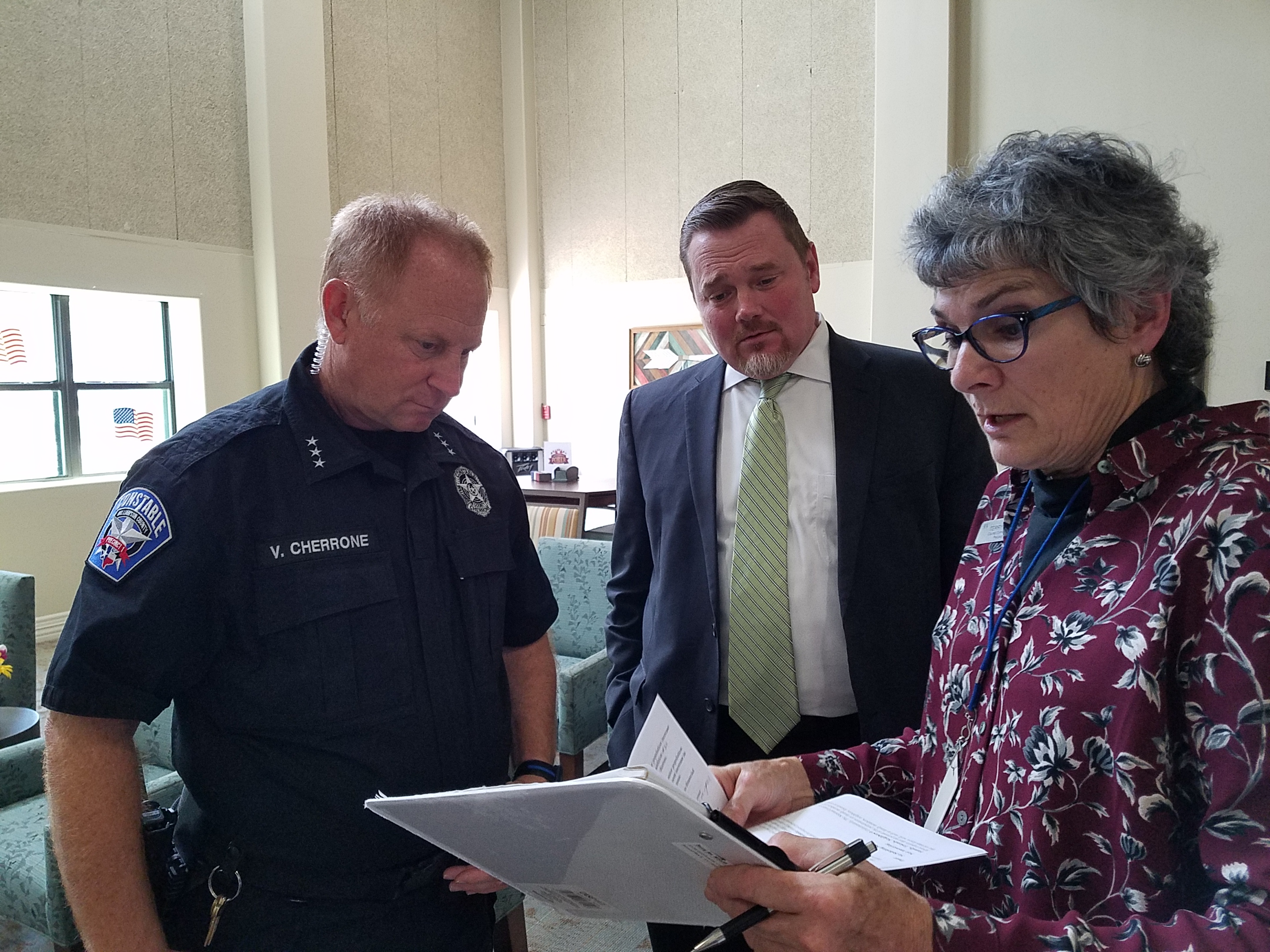 Commissioner Cook shares senior fraud information with Precinct 1 Constable Vinnie Cherrone and Wilco County Attorney Dee Hobbs.