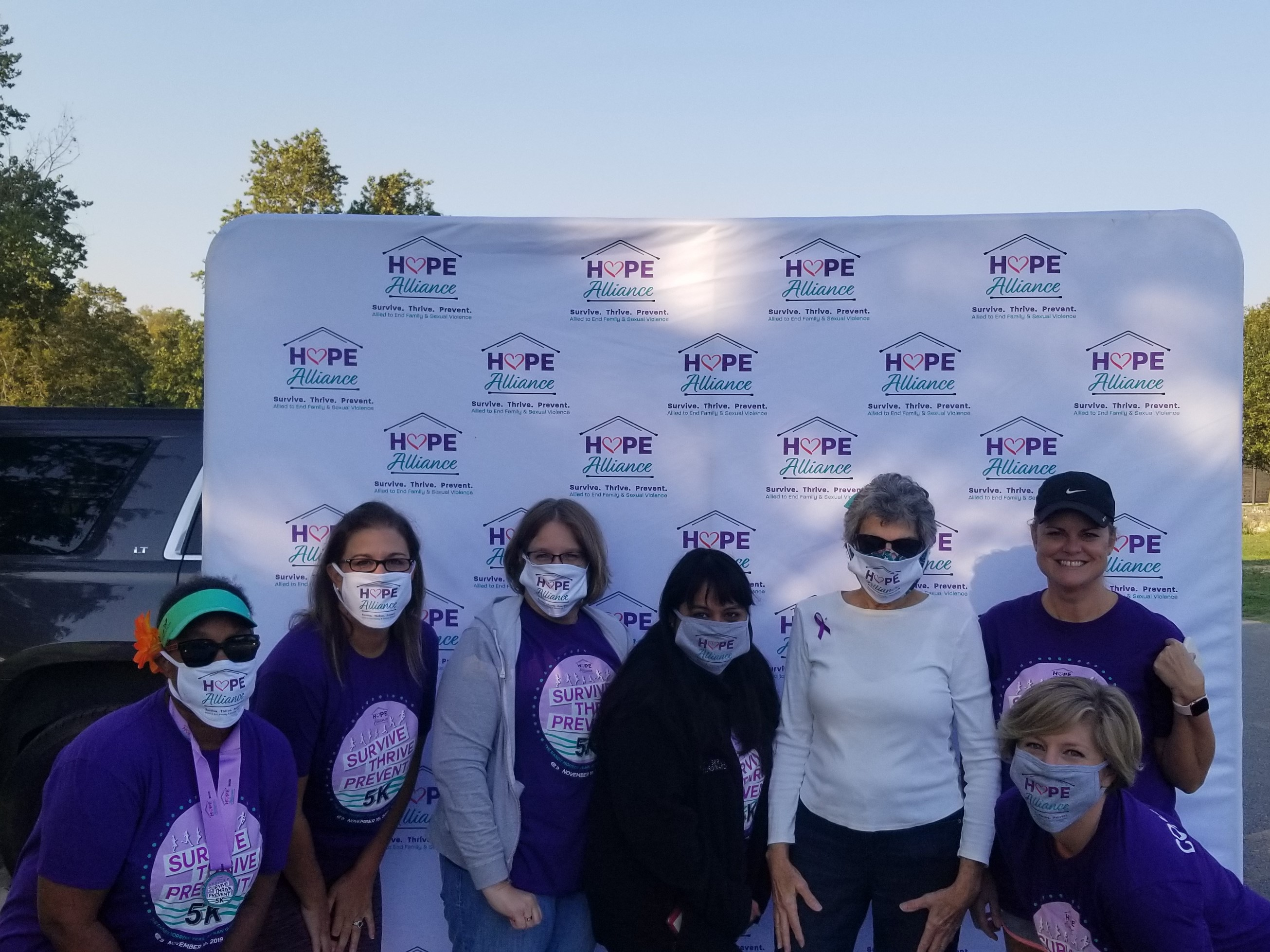 Volunteer committee members for the Hope Alliance Virtual 5K Race pose with Commissioner Terry Cook at San Gabriel Park in Georgetown. They are from left, Patricia Fowler, Natalie McKinnon, Tracy Lyke, Priscilla Moreno, Cook, Lesa Cantrell and Jamie Felicia (kneeling).
