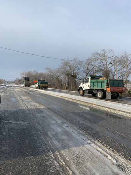 Once the scrapers cleared SH-195 from I-35 to Florence, dump trucks driven by Williamson County employees Jimmy Cloud, Garrett Michalk, Garrett Draehn and Mark Chaidez spread sand over the icy roads that allowed the electric provider to get the transformer to Florence.