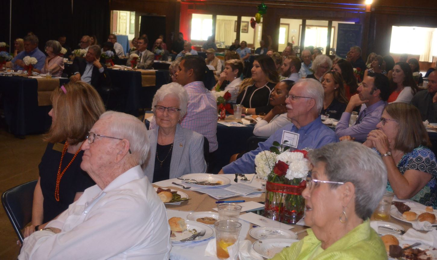 Seated facing forward are Barbara and George Brightwell who were honored as founders of LifeSteps with other members also seated.