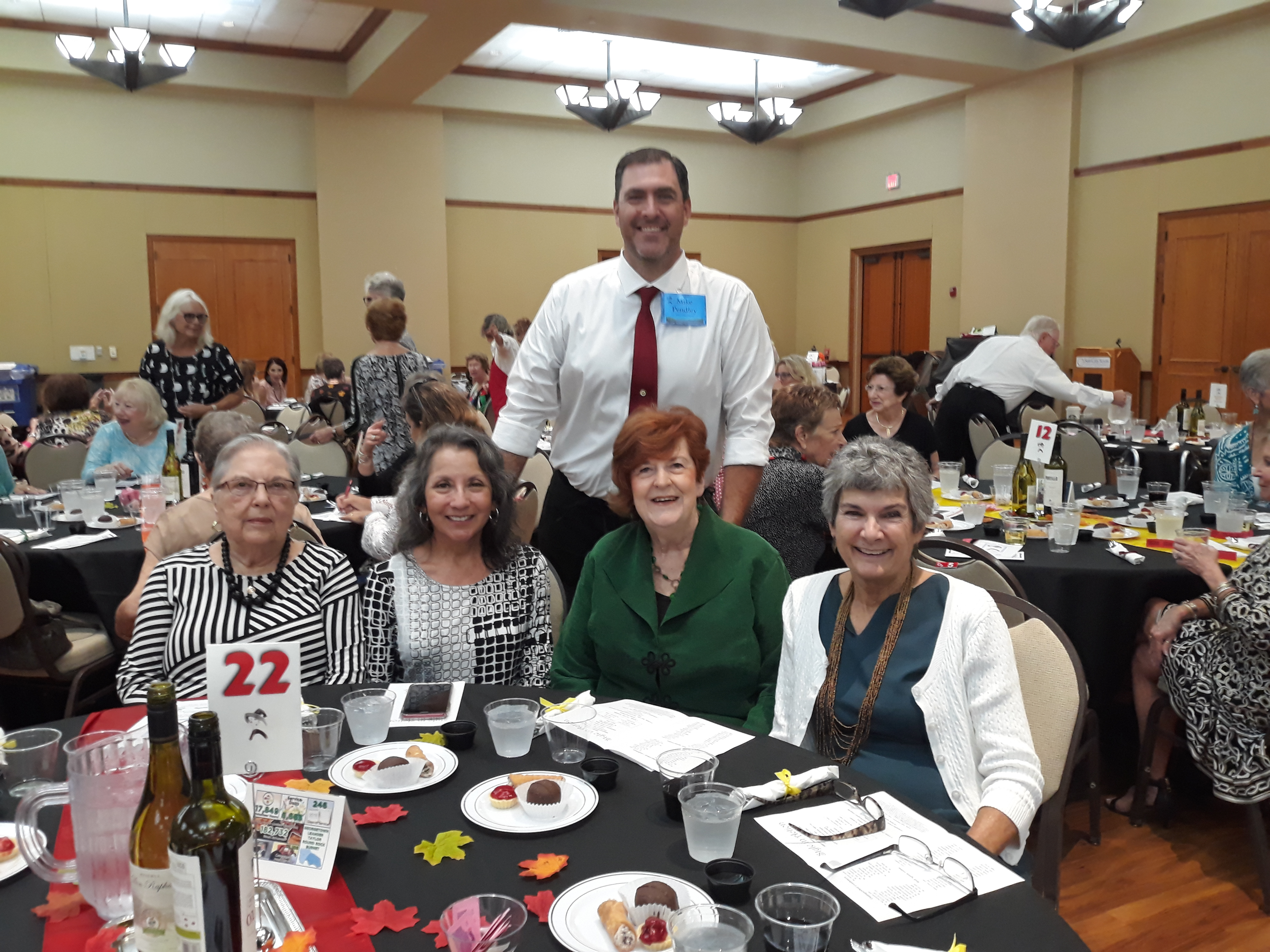 Joining Commissioner Cook at her table were Sun City residents (lft to rt) Karen Mulkey, Janie Clark and Barb Bigger and Precinct 1 Chief Deputy Constable Mike Pendley, the table's server and winner of highest tipped server.
