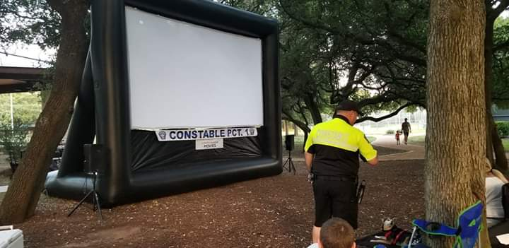 The big screen is ready for Willy Wonka as local residents begin to find places.