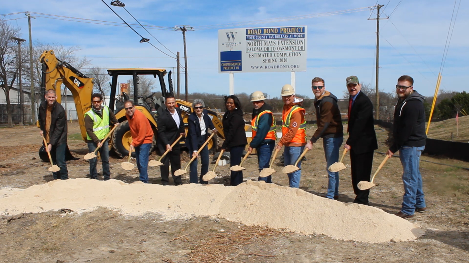 Officials from the County, City of Round Rock, Design Engineer LJA and contractors with Capital Excavation hold shovels of dirt to break ground on the north end parking lot of the Round Rock Public Safety Facility.