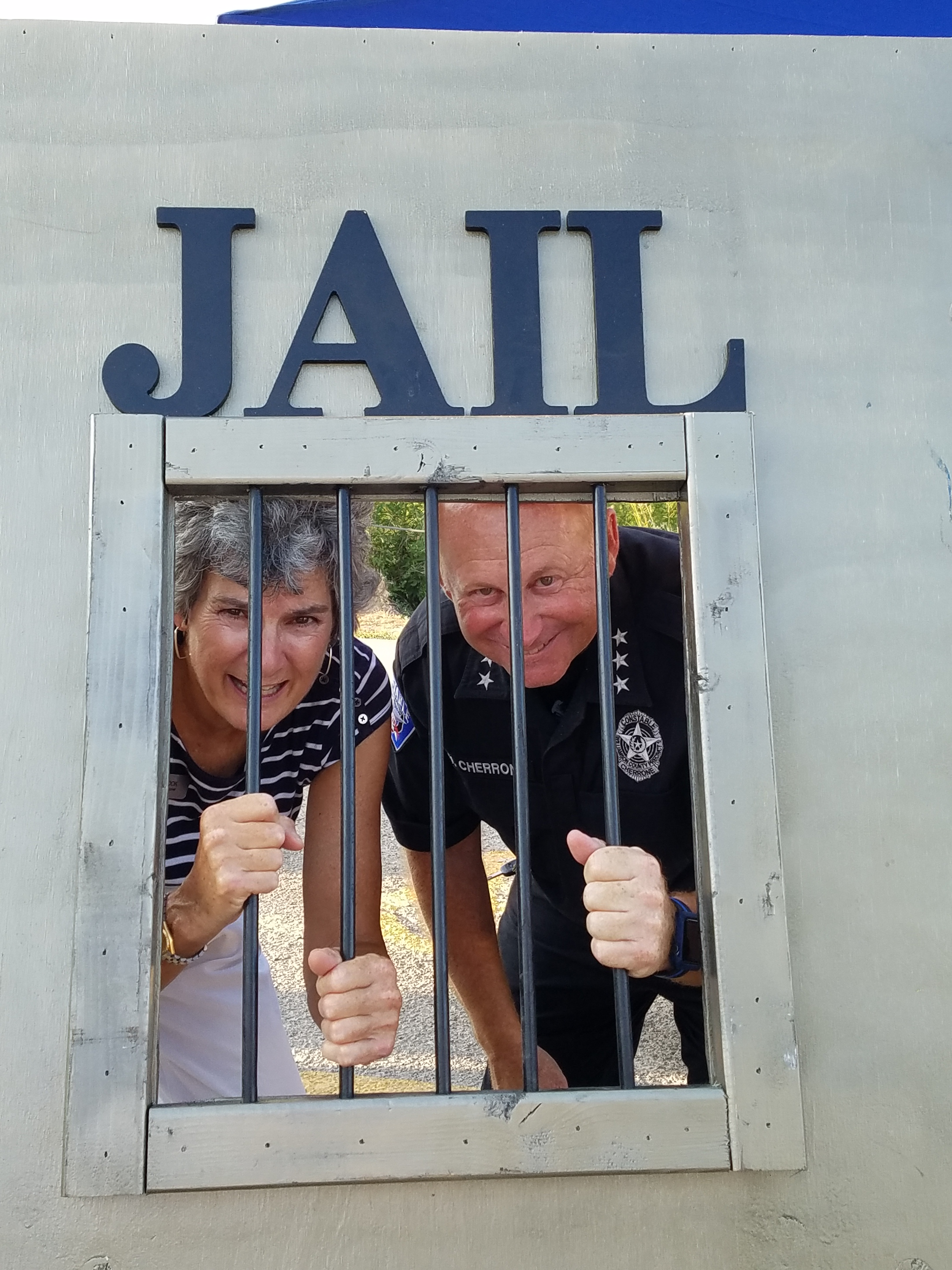 Commissioner Cook and Constable Pct. 1 Vinnie Cherrone stand behind the makeshift jail front.