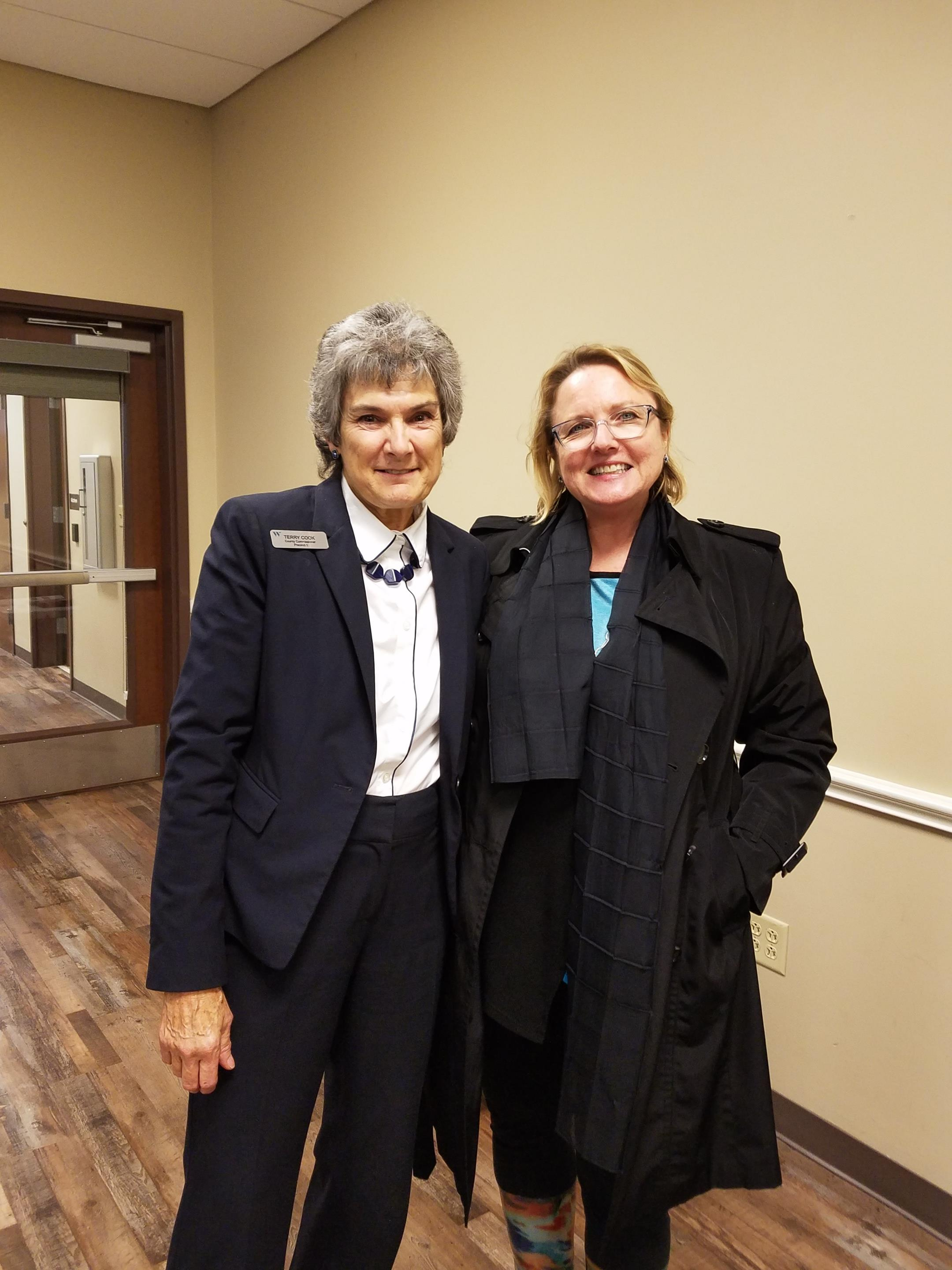 Commissioner Cook is shown with Rattan Creek Neighborhood Association President April Bliss.