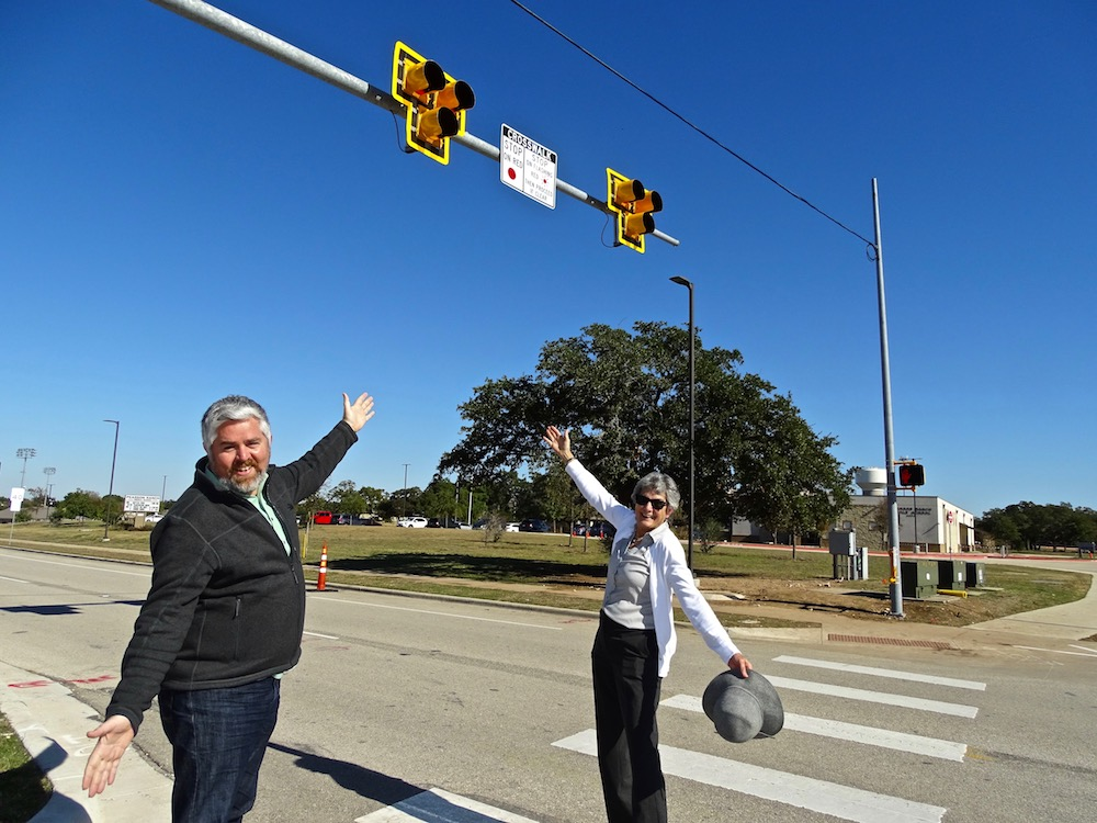 District 6 Austin Council Member Jimmy Flannigan and Commissioner Cook raise their hands into the air to showcase the new PHBs.