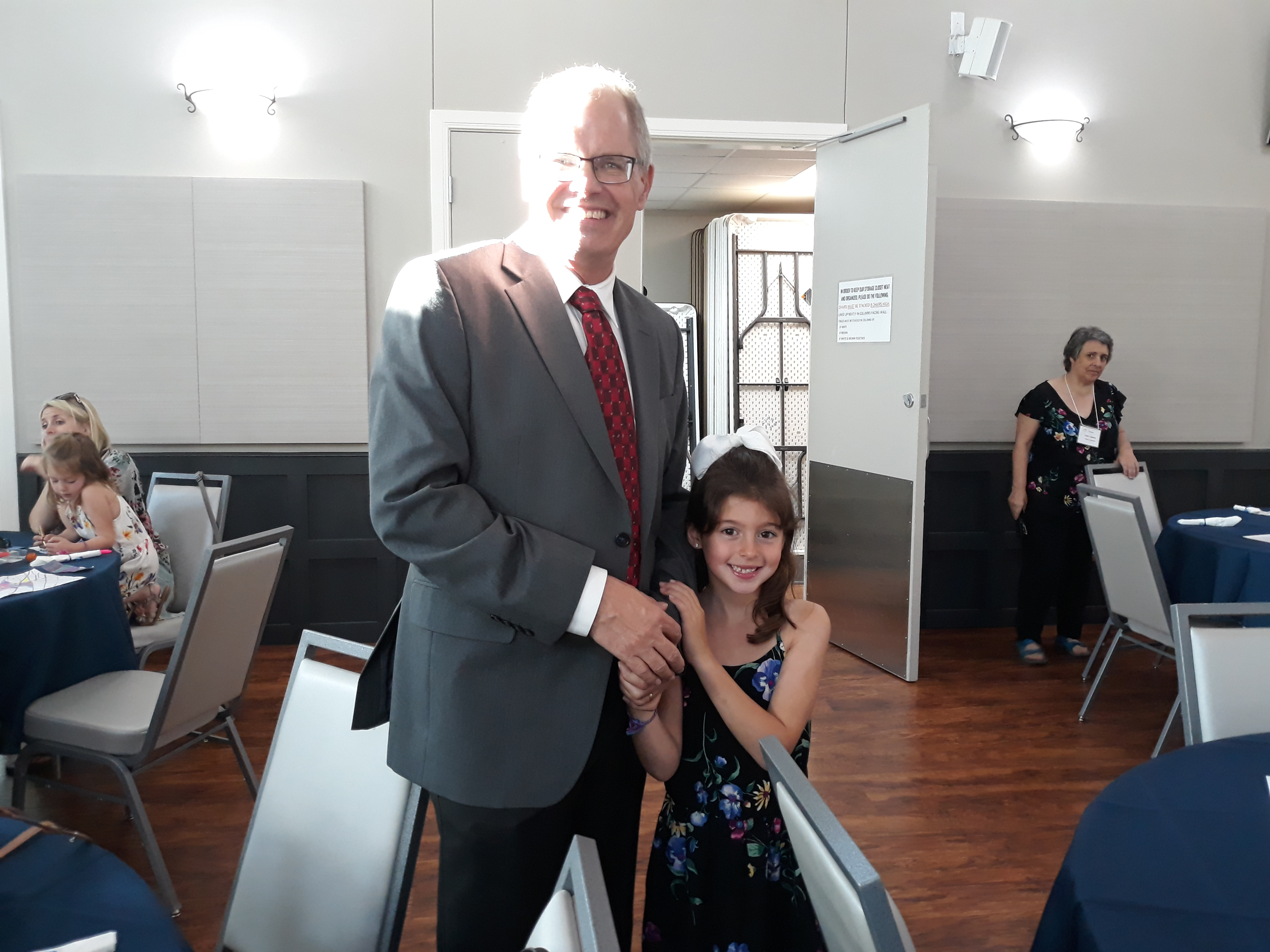 Executive Director of Pavilion Gordon Butler and his granddaughter enjoy a moment together before the program.