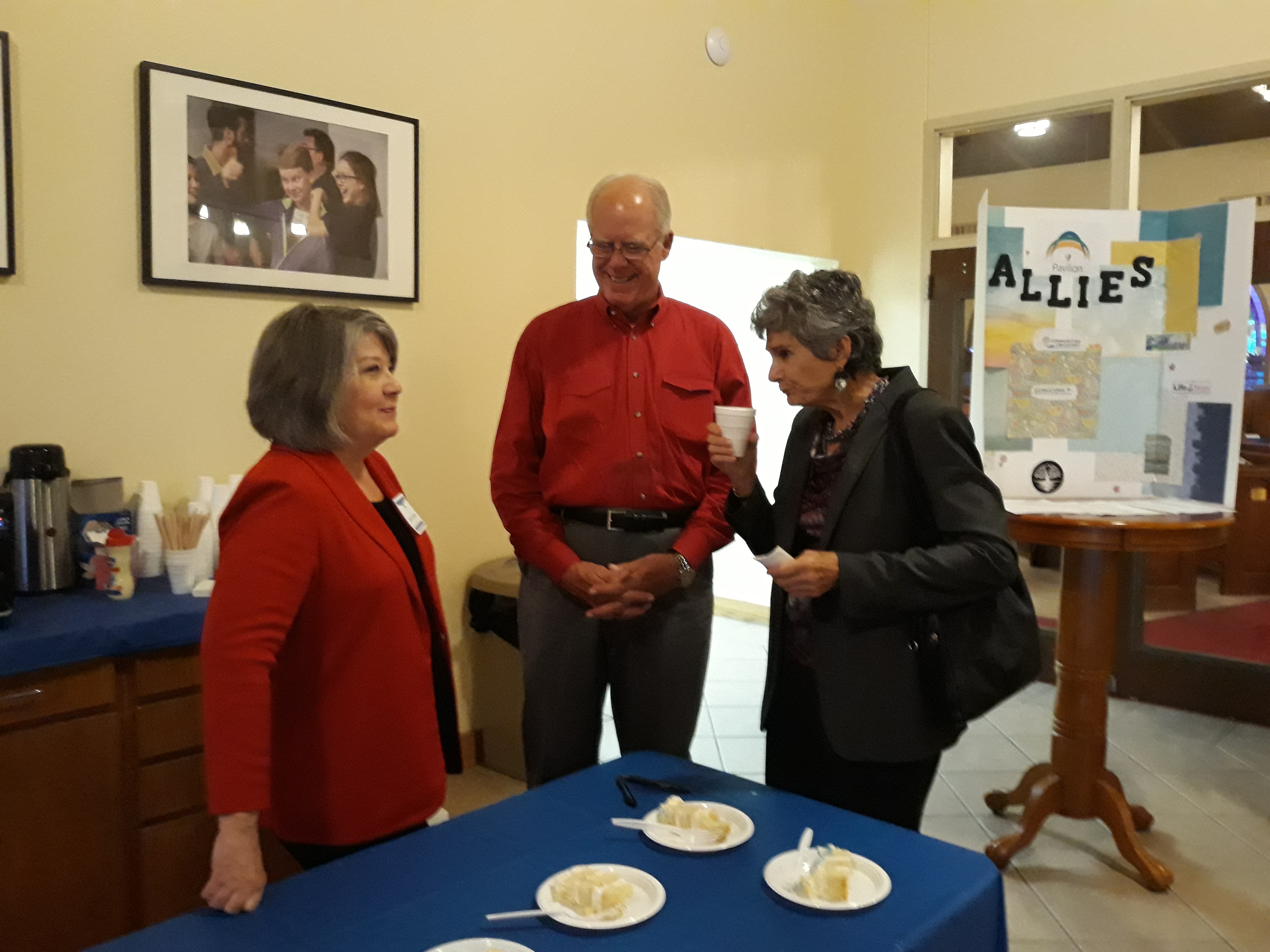 Commissioner Cook chats with Pavilion volunteers Laura Lantrip and her husband Lynn, Principal with GRS Consulting.