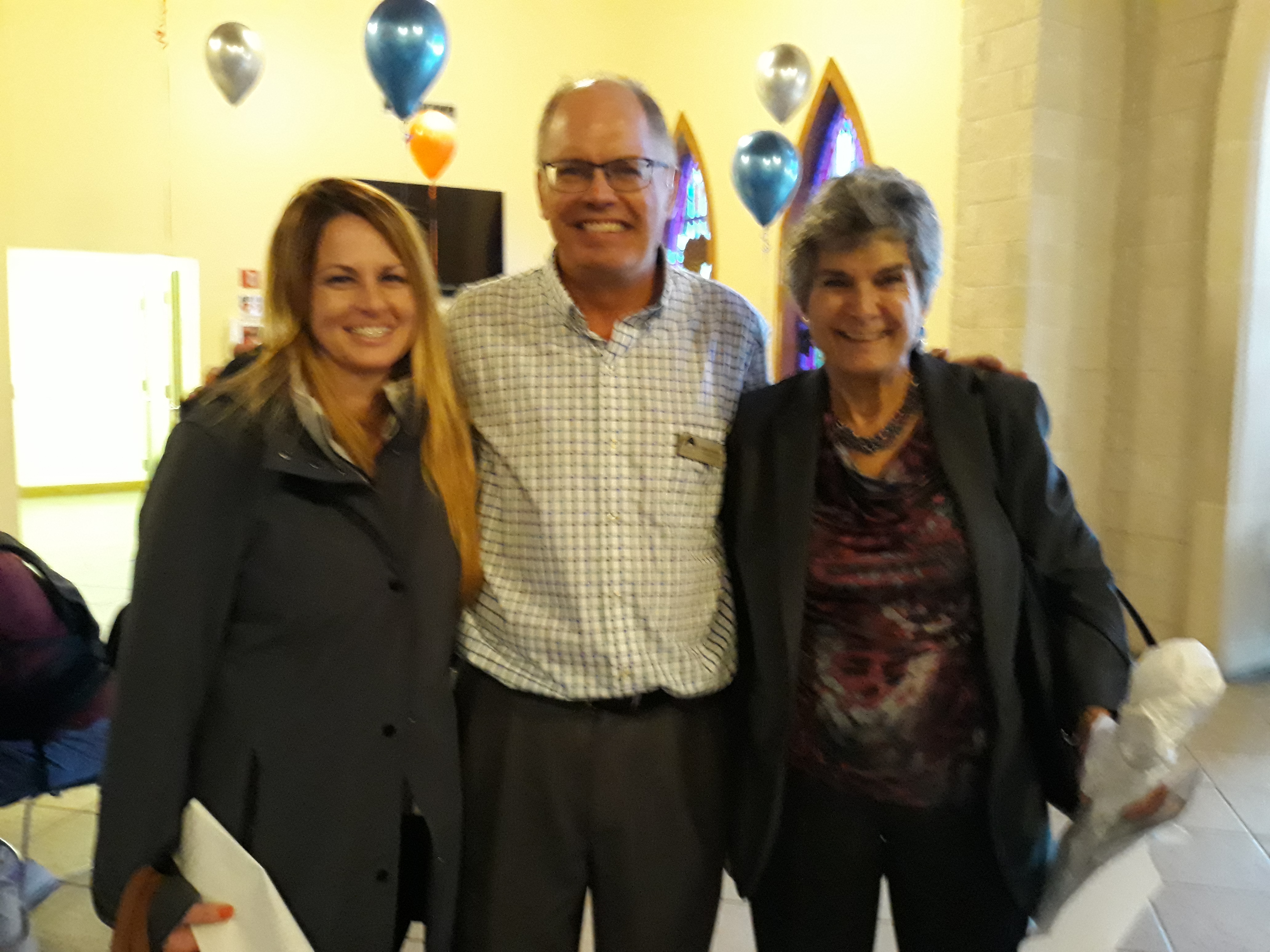 Celebrating the second birthday of Pavilion at the Open House are lf to rt Tiffany Gonzalez, Bluebonnet Trails Director of Behavioral Health; Gordon Butler, Pavilion Executive Director; and Commissioner Cook.
