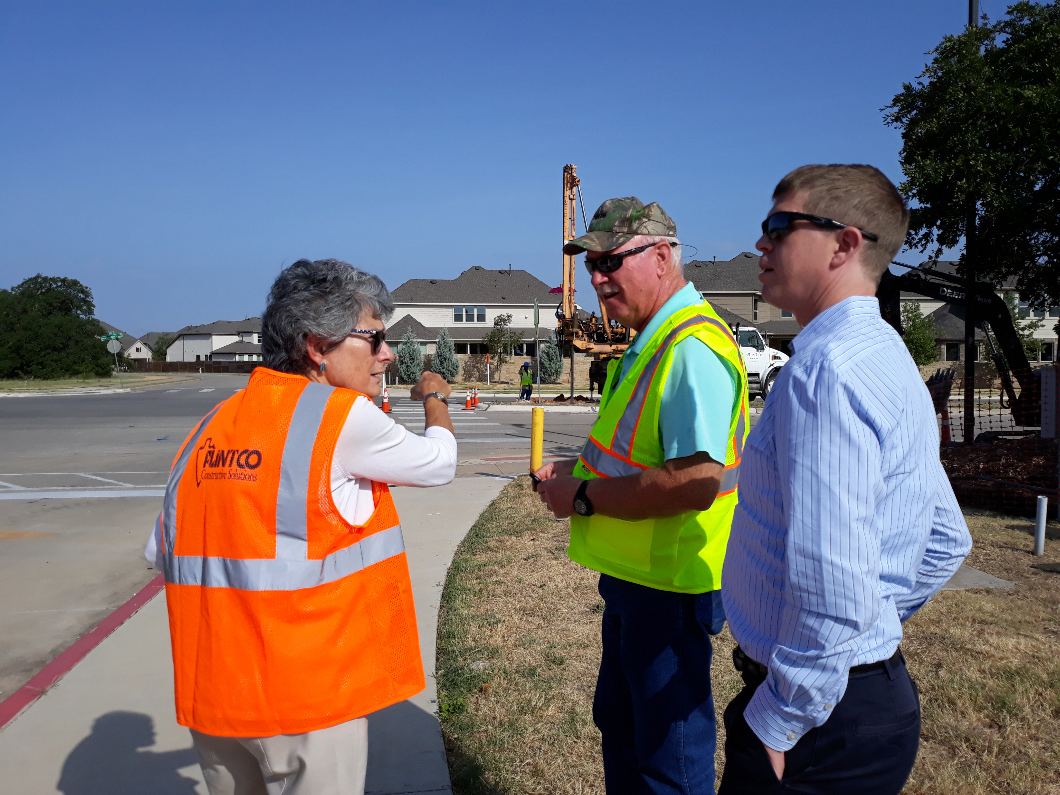Commissioner Cook discusses the project's progress with Clayton Weber (lf) and Eddie Church (rt) from HNTB Corporation.