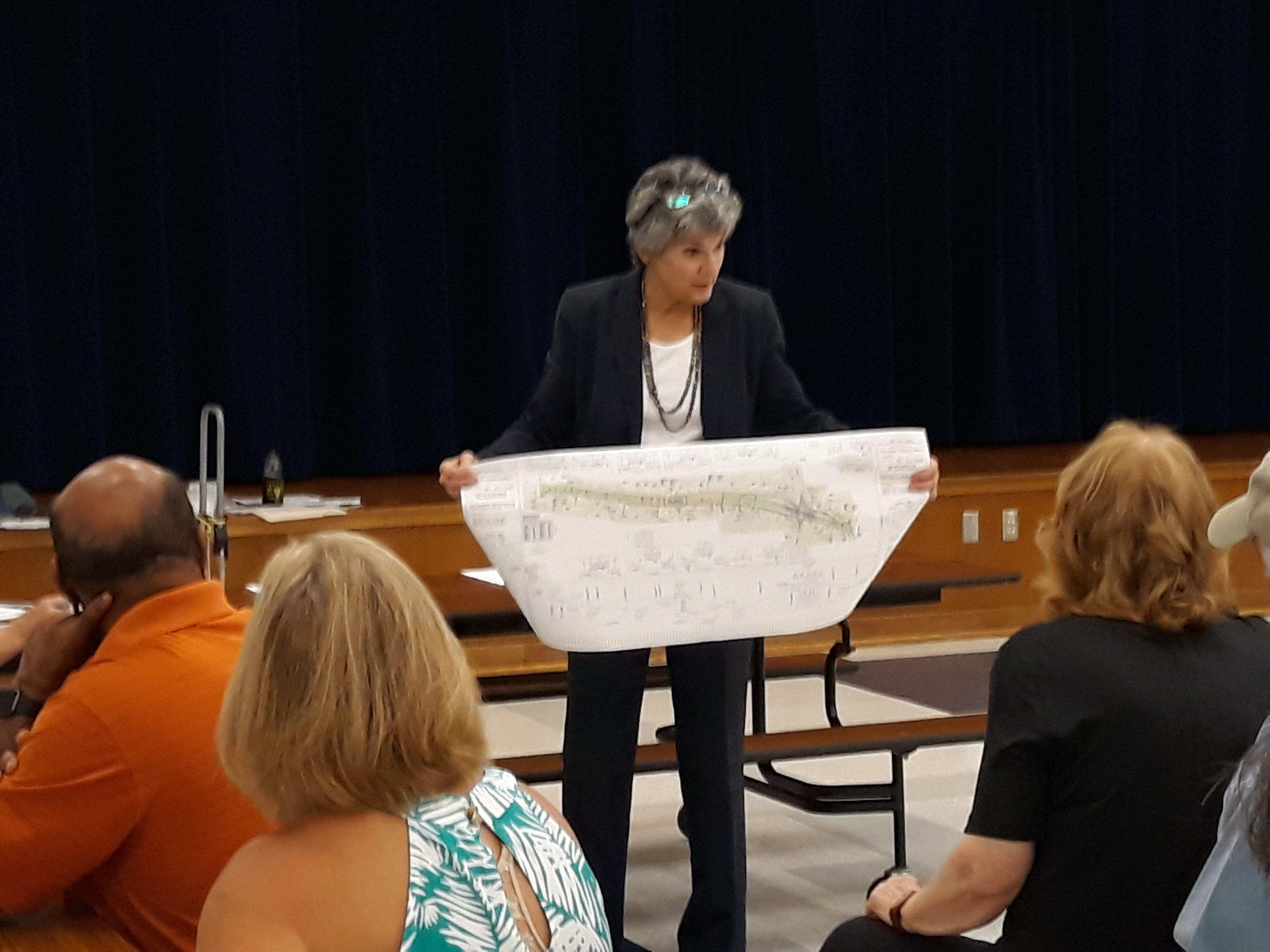 Commissioner Cook shows a map of the Brushy Creek Trail with the areas needing connections.