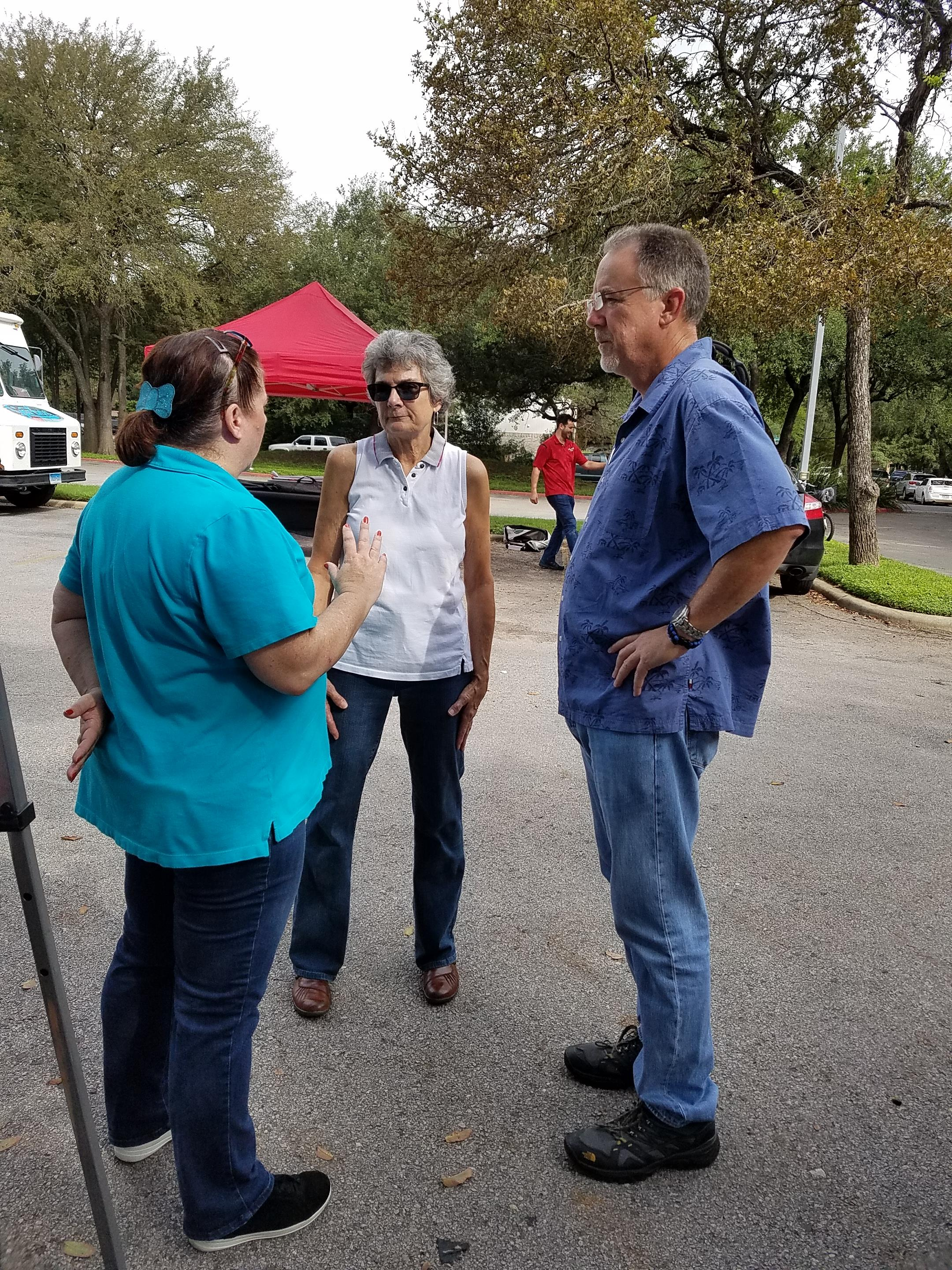 Commissioner Cook chats with North Austin MUD 1 Board Members Jo Jones and Don Conklin.