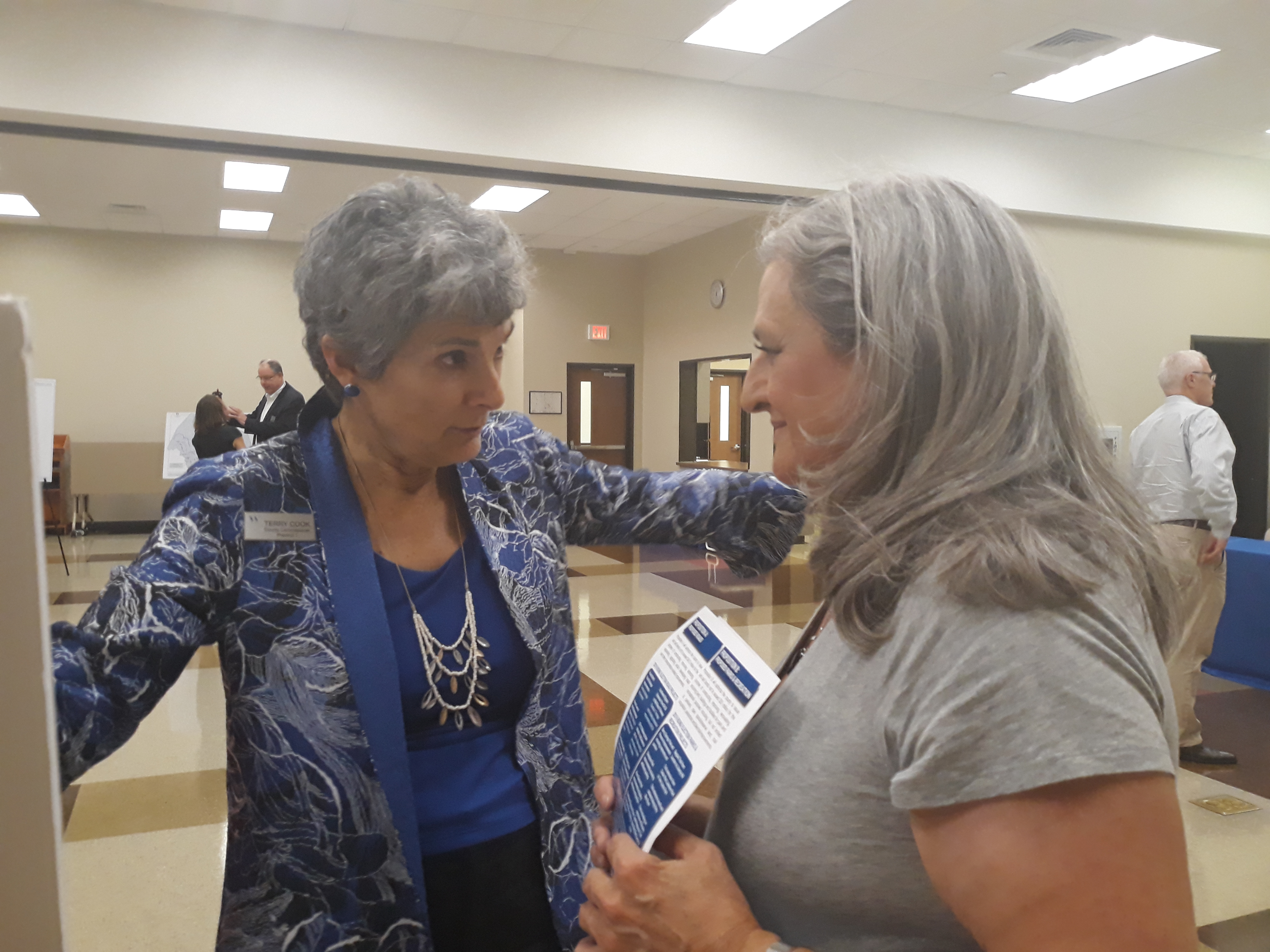 Commissioner Cook and Cedar Park resident Maria Talamo exchange their thoughts on the bond election impact in Ms. Talamo's area.