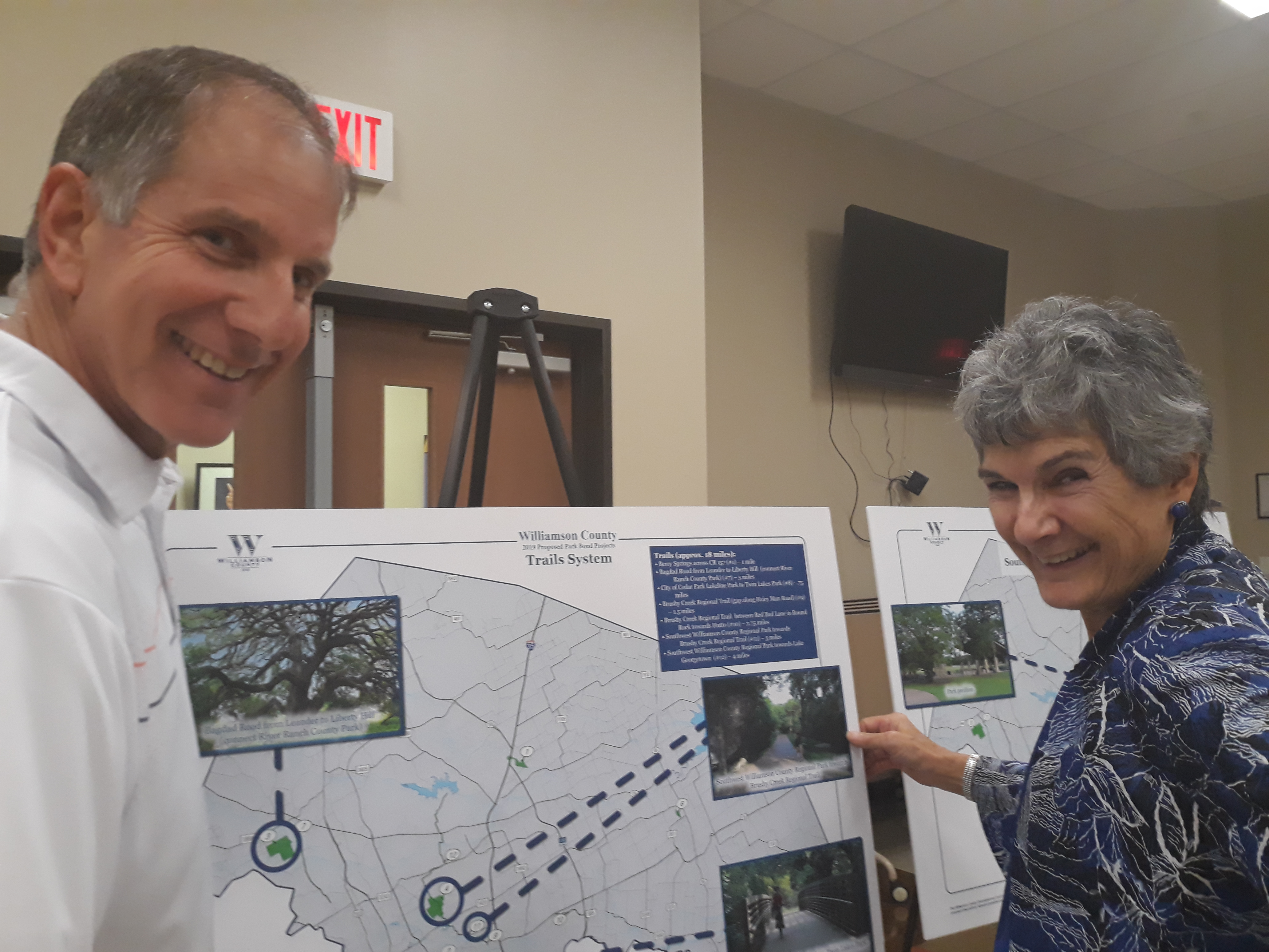 Commissioner Cook and Sr. Dir. of Wilco Parks & Recreation Russell Fishbeck discuss the impact of the road bonds shown on the chart.