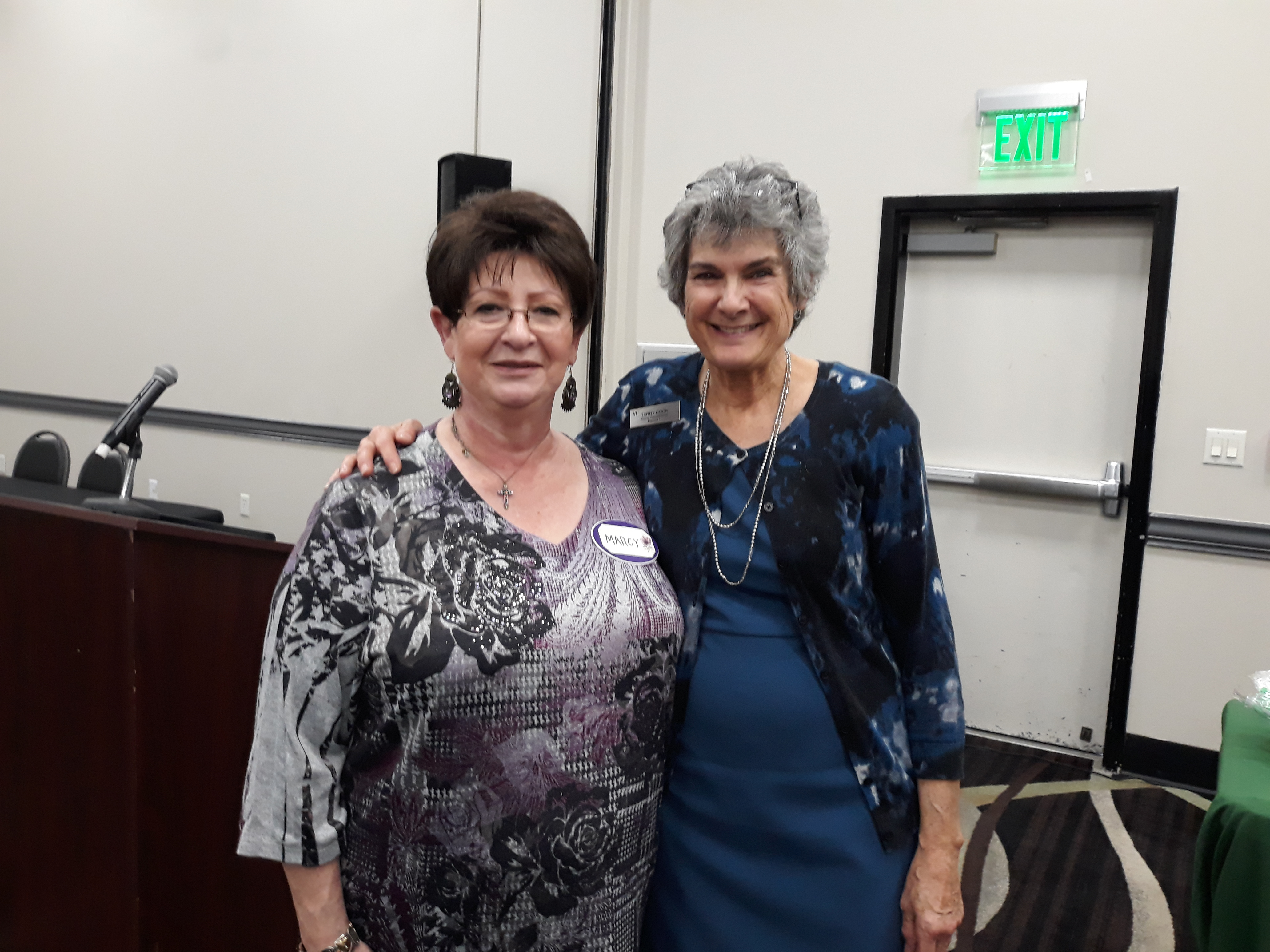 Round Rock New Neighbors Programs Director Marcy Delgado invited Commisisoner Cook standing by her to speak about fraud prevention at the group's monthly meeting.