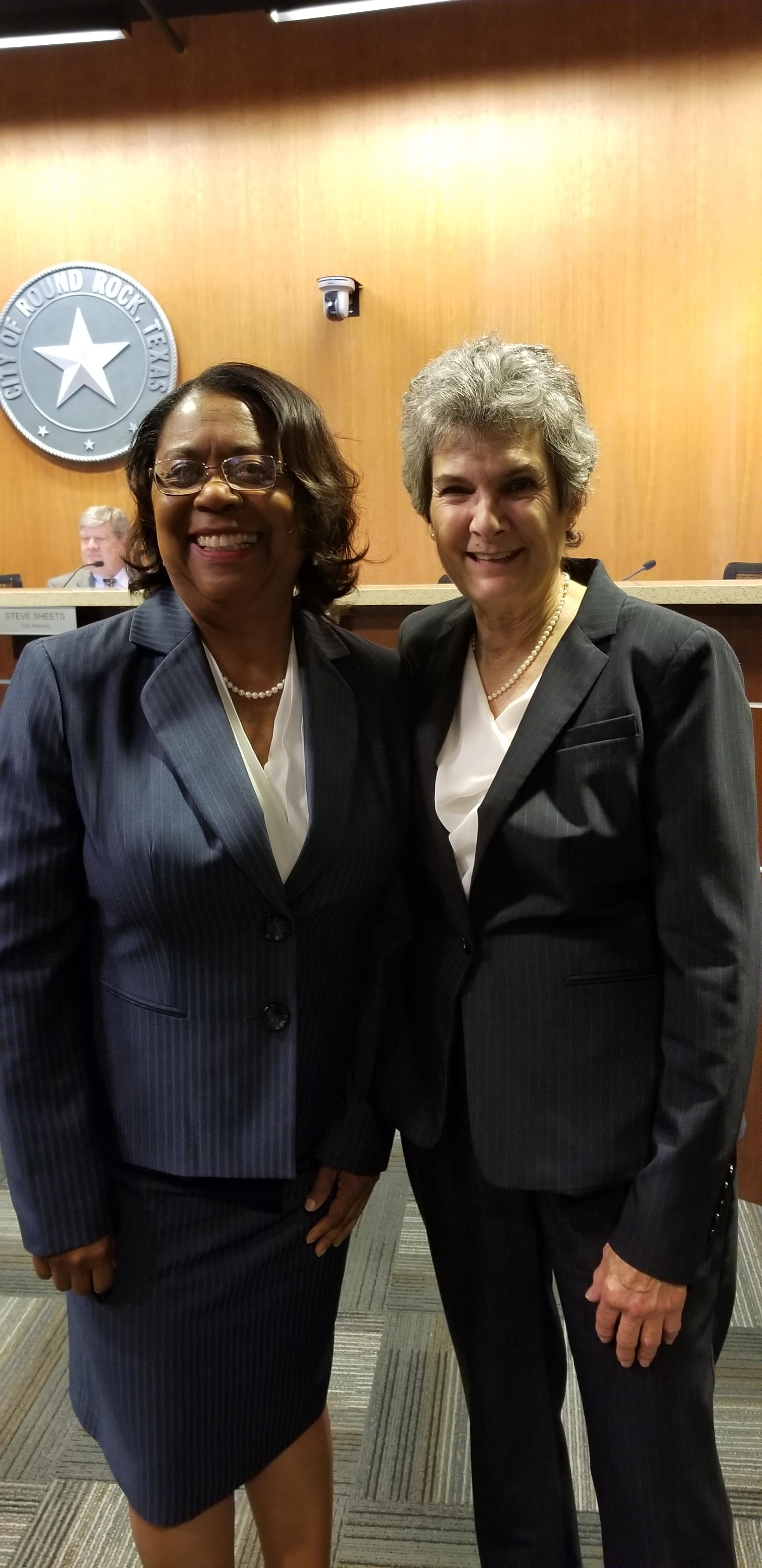 Commissioner Cook stands with Council Member Hilda Montgomery after she swore in the Council Member for her second term on the Round Rock City Council.