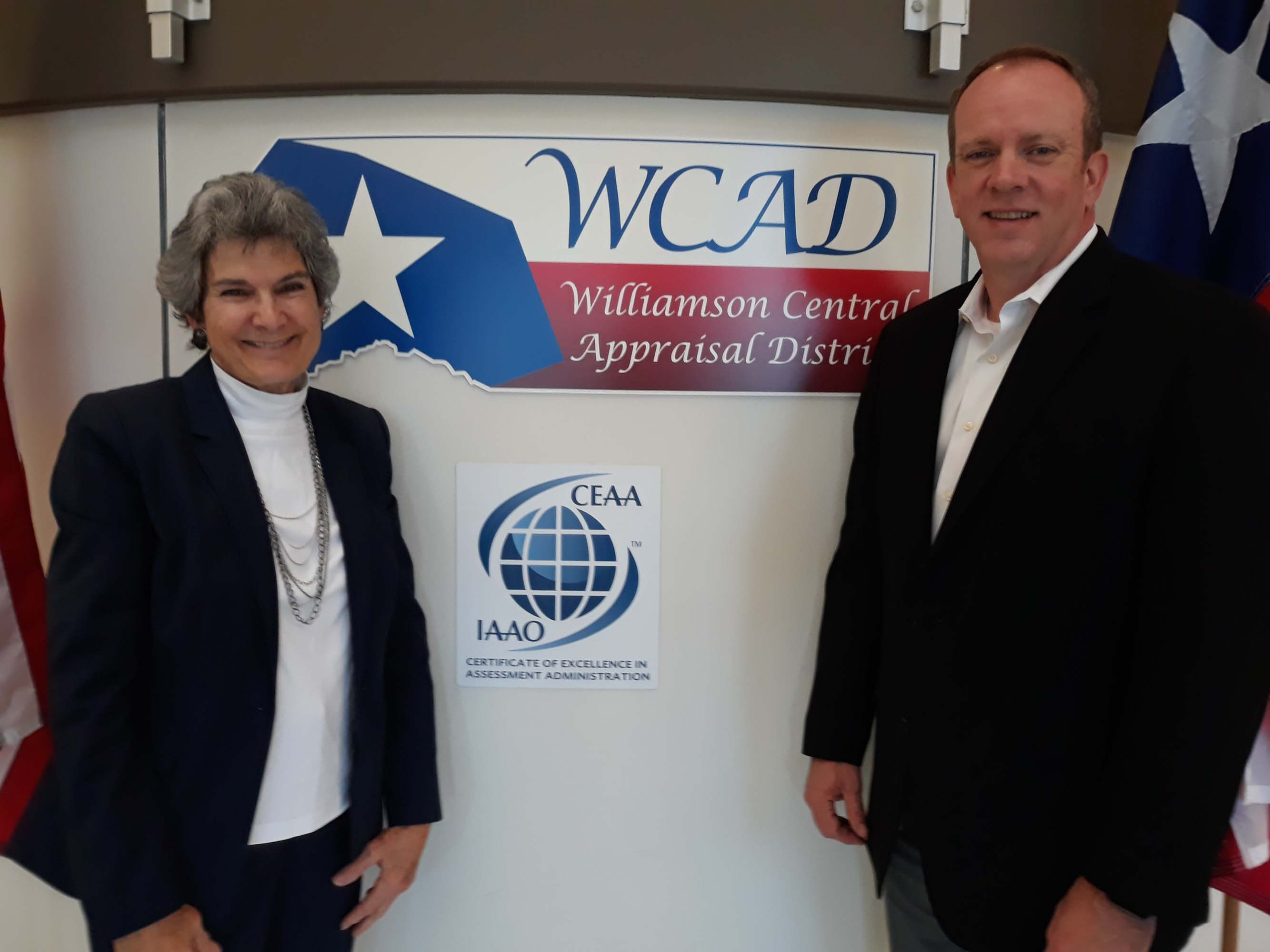 Commissioner Cook and Alvin Lankford, Williamson County's chief appraiser, flank the Certificate of Excellence in Assessment Administration plaque the Williamson Central Appraisal District received in 2013.