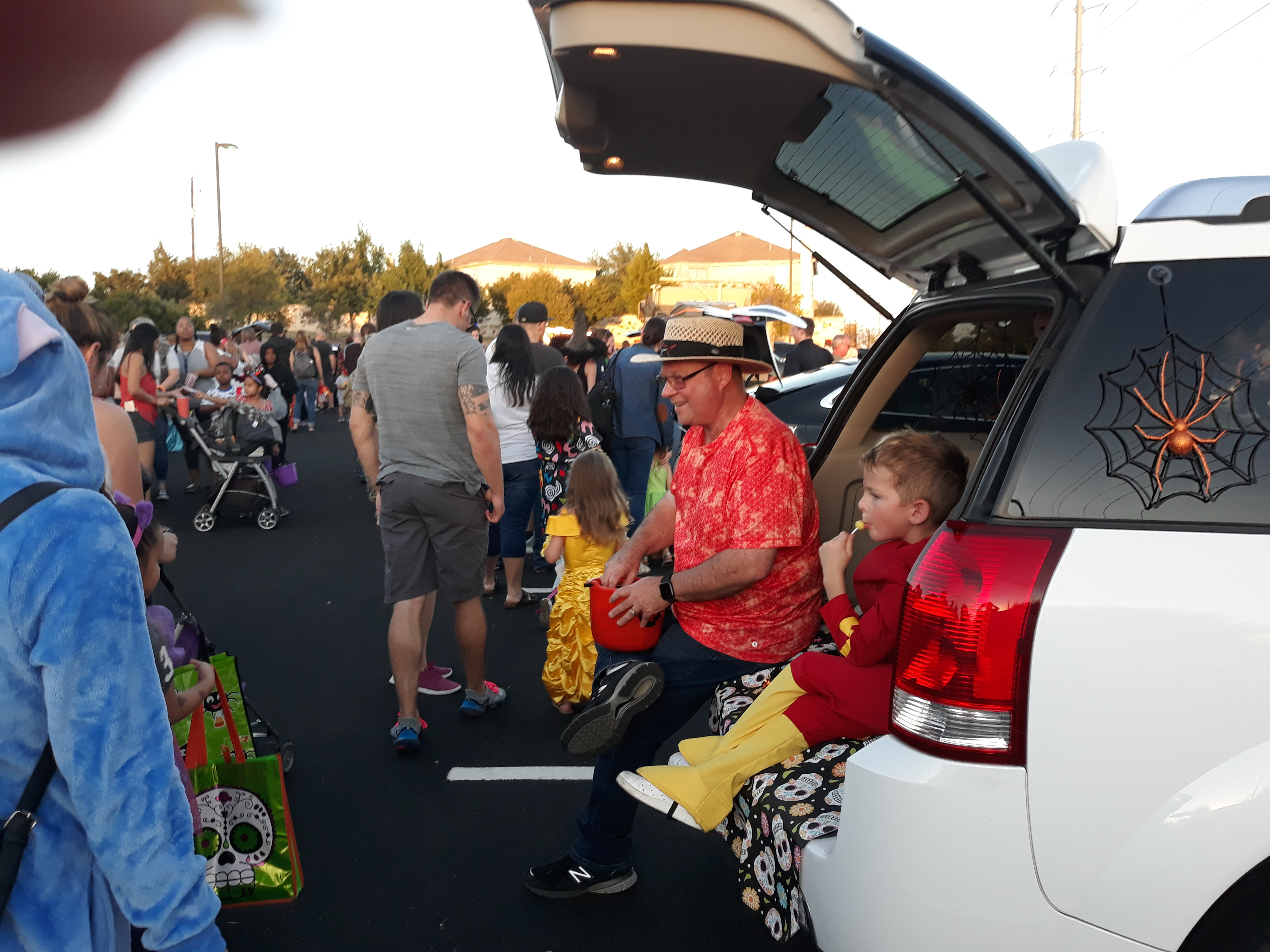 Jeff Johnson of Precinct 1 hands out candy to hundreds of kids. Grandson Liam Johnson looks on while enjoying a lollipop.