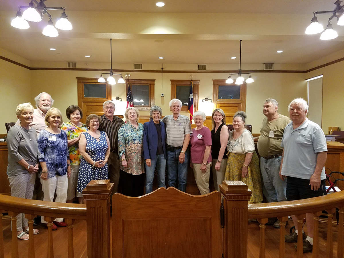 Commissioner Cook and the WCHC Board members are pictured at the front of the Williamson County Historic Courthouse at one of their meetings.