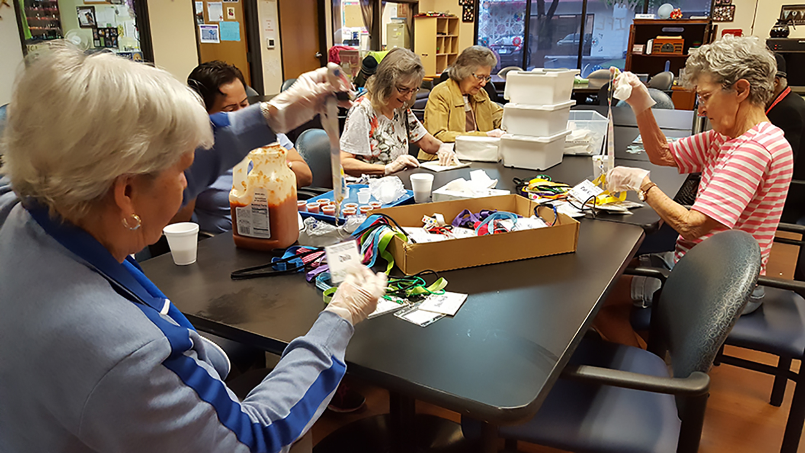 Members of the AGE Thrive Social and Wellness Center in Williamson County enjoy a day of socializing and creativity with art projects.